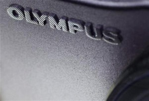The logo of Olympus is seen on its camera at an electronic shop in Tokyo